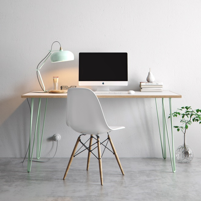 A white desk with mint green hairpin legs