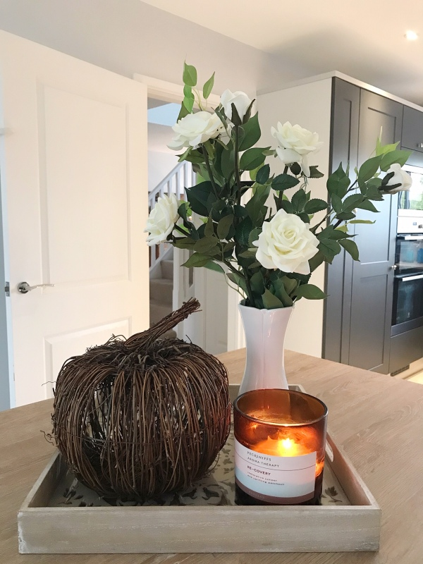 Cozy kitchen featuring fall pumpkin and candle